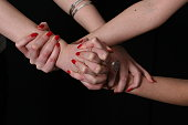 Girls squeezing fingers