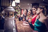 Girls standing in a bar