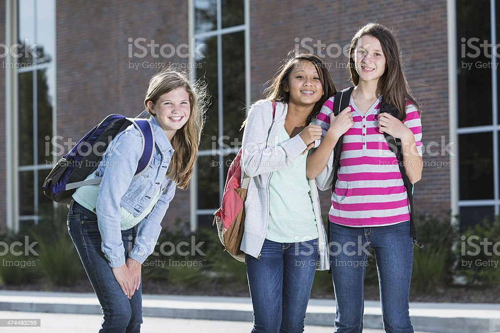 Girls standing outside school stock photo
