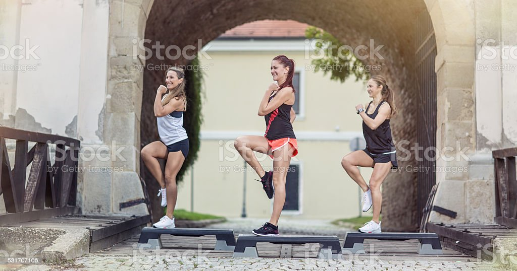 girls stepping on exercising steeper stock photo