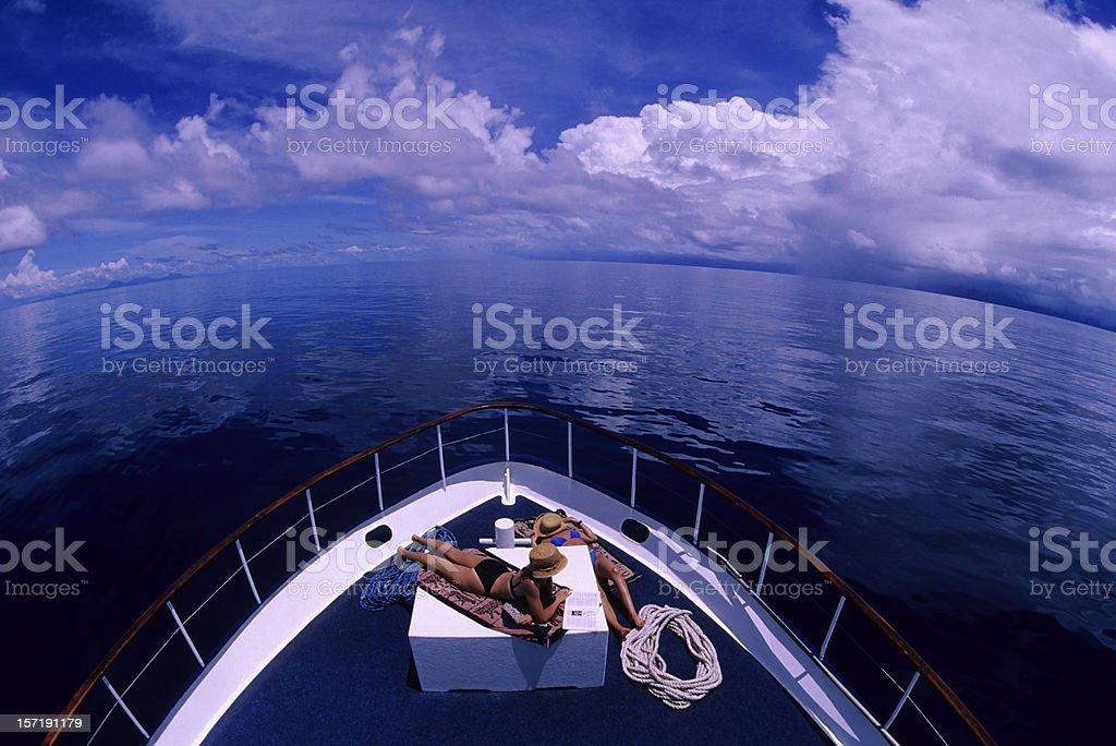 Girls Sunbathing On Boat royalty-free stock photo