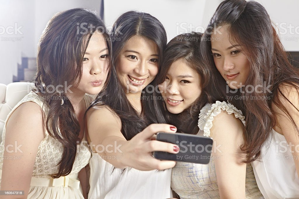 Girls taking picture royalty-free stock photo