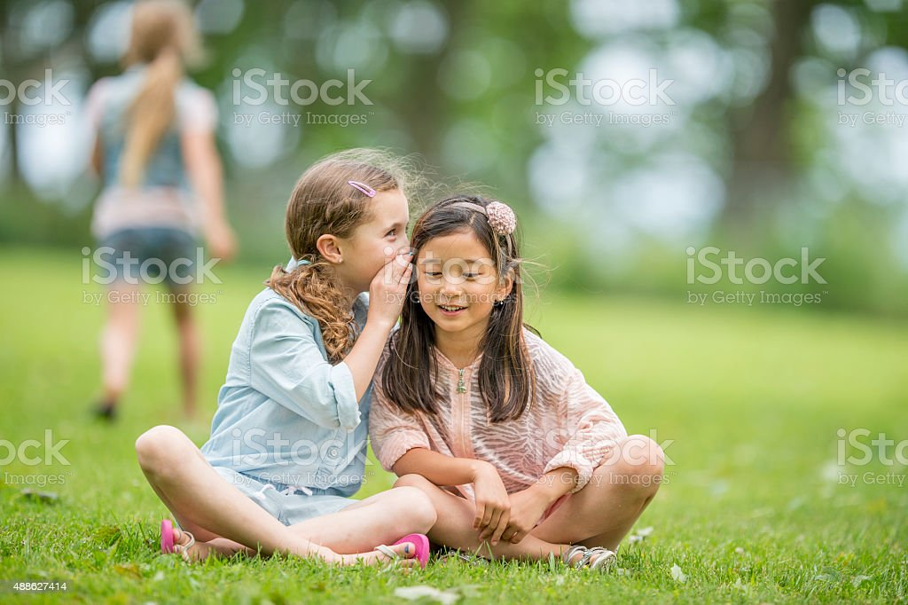 Girls Telling Secrets stock photo