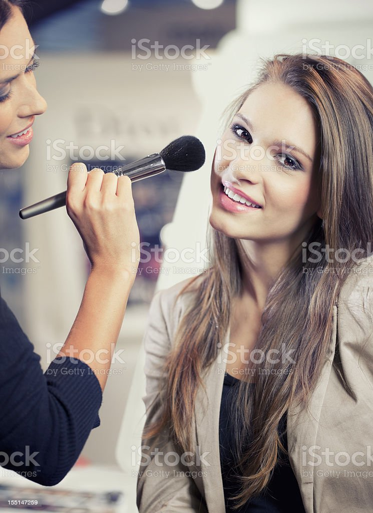Girls testing and  purchases cosmetics in the beauty shop royalty-free stock photo