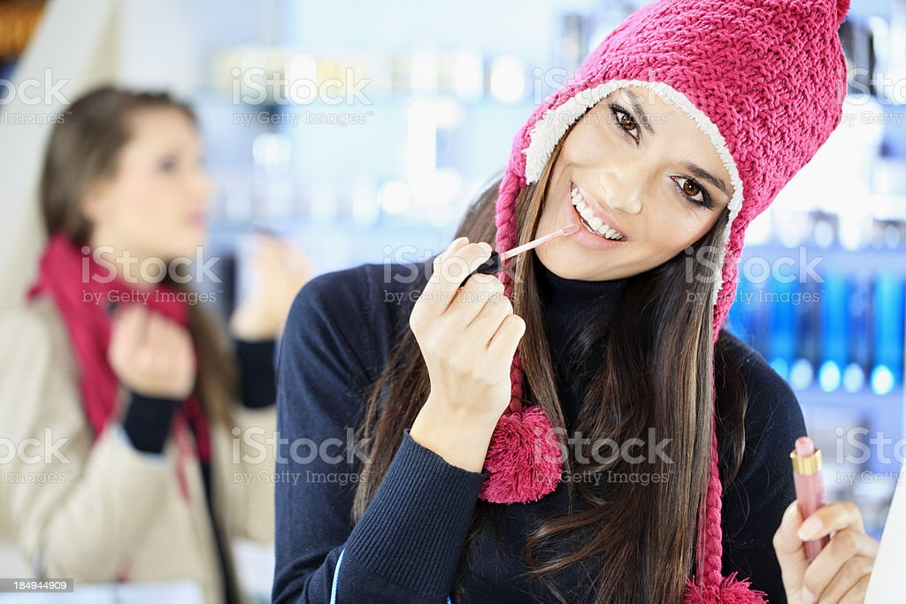 Girls testing and  purchases cosmetics in the beauty shop stock photo