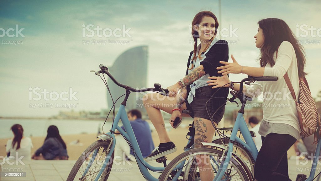 Girls together have relax by the sea in the city stock photo