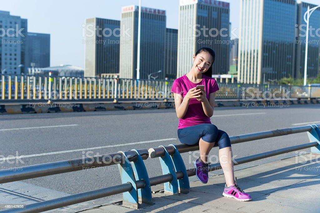 girls using mobile phones stock photo