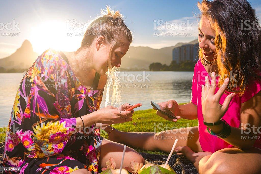 Girls using smartphone stock photo