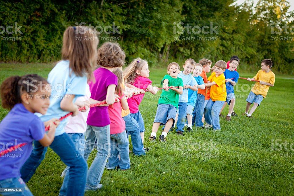Girls Versus Boys Tug of War Game Outside stock photo