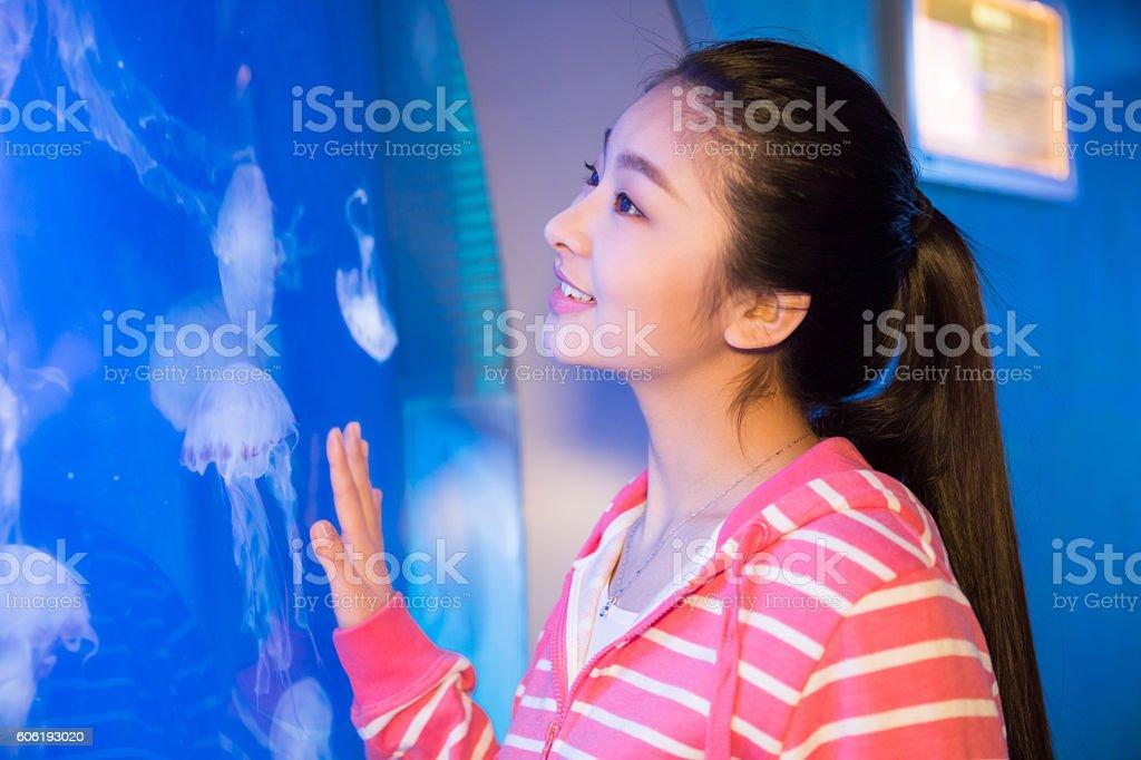 girls visit the aquarium stock photo