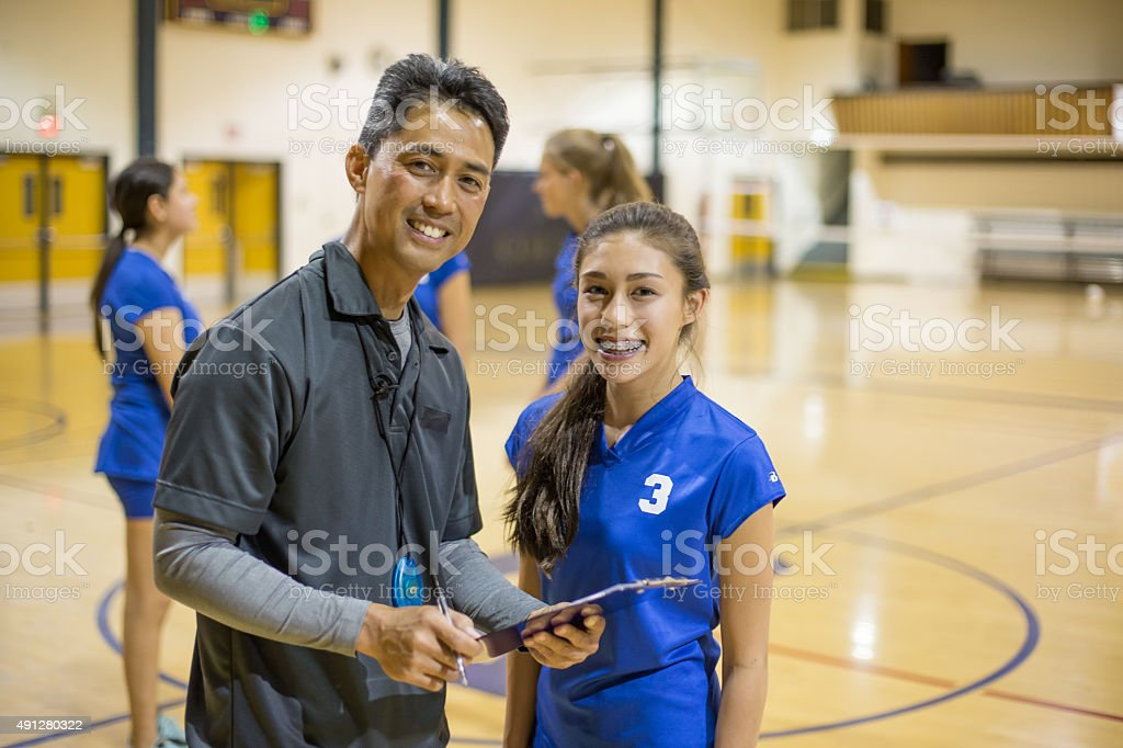 Girls volleyball player with coach stock photo