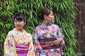 girls wearing kimono costume at  street of  kyoto japan