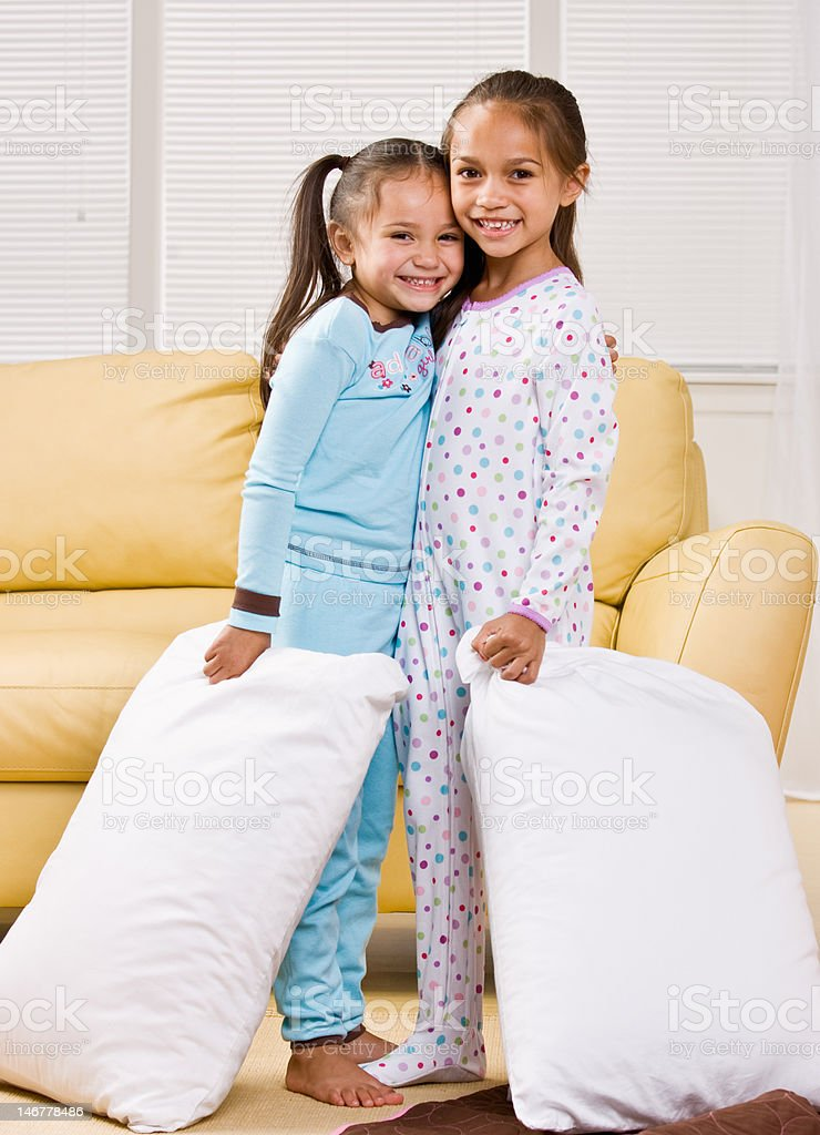 Girls wearing pajamas in livingroom stock photo