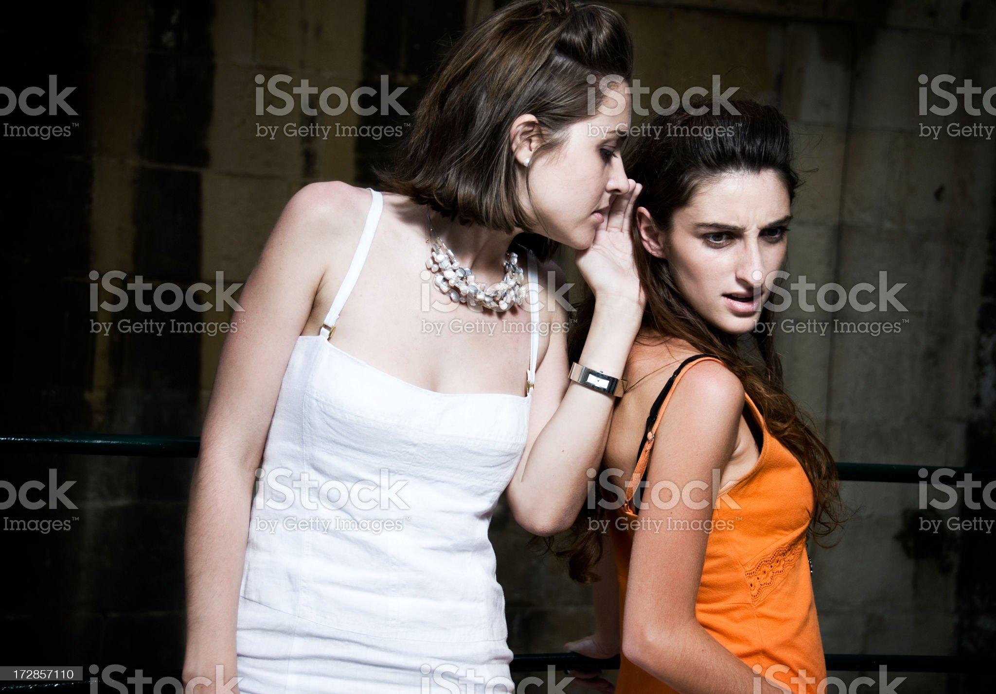 Girls whispering a gossip royalty-free stock photo