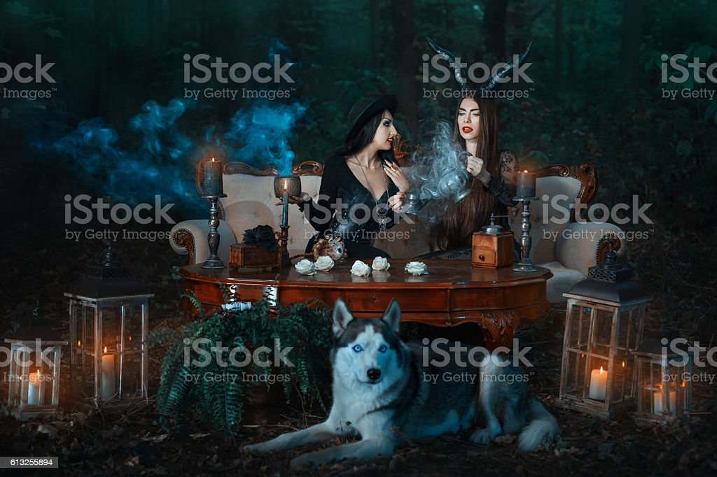 Girls witch in the woods conjure. stock photo