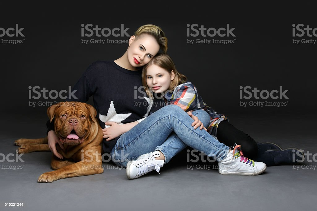 Girls with big brown dog stock photo