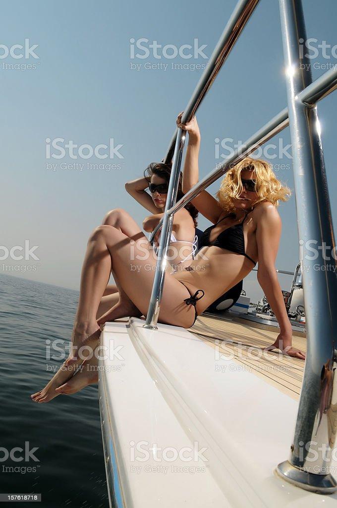 Girls with bikini on the yacht royalty-free stock photo
