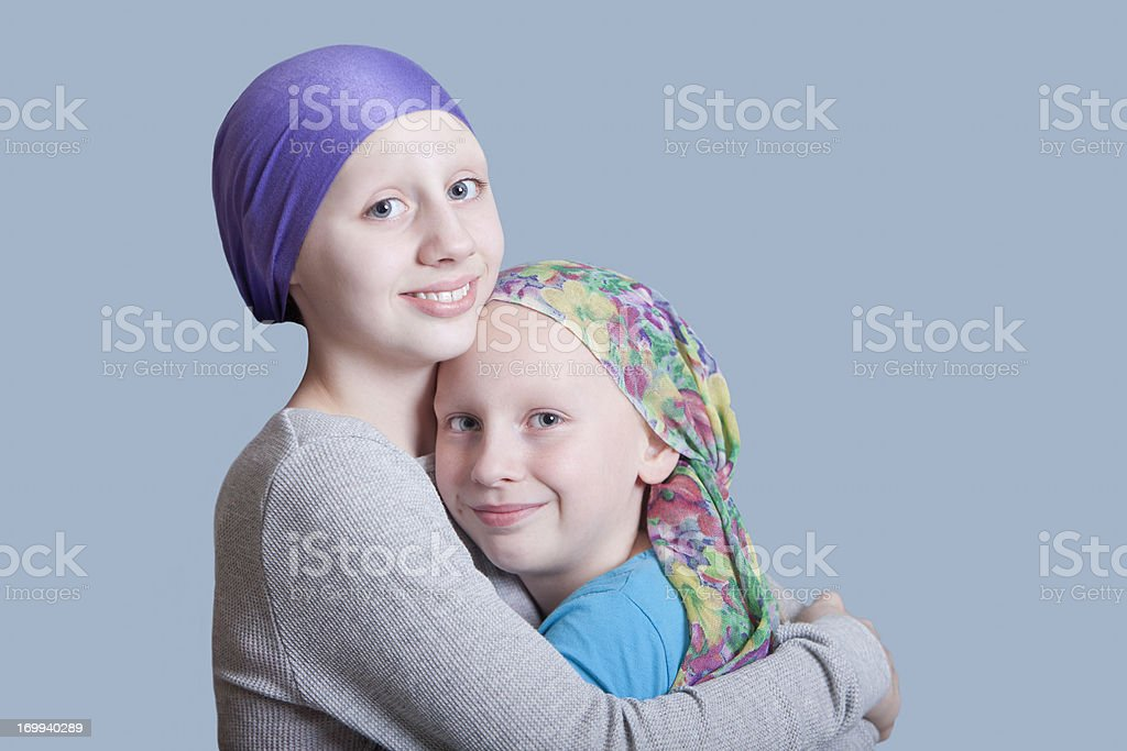 Girls with Cancer Hug Close Up stock photo