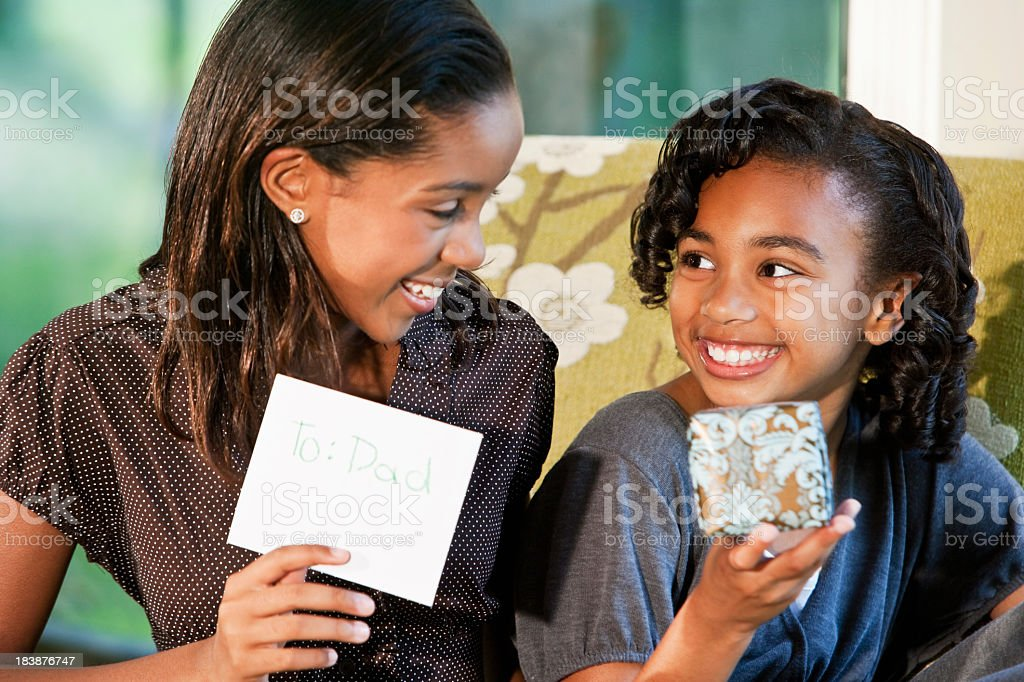 Girls with gift for father royalty-free stock photo