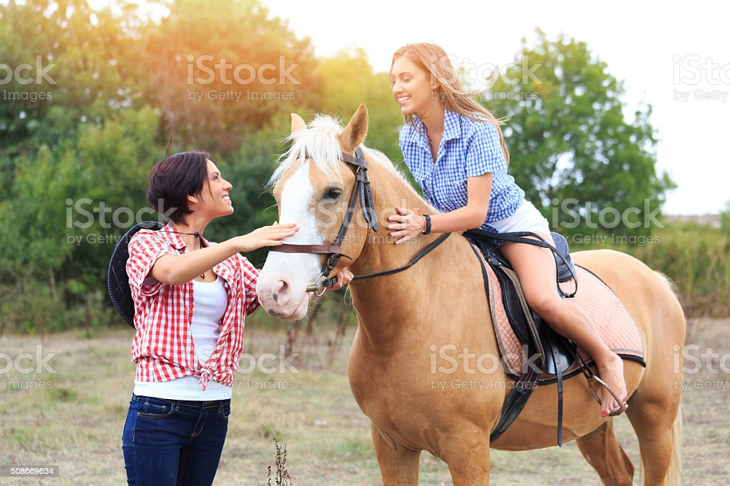Girls with horse in nature stock photo