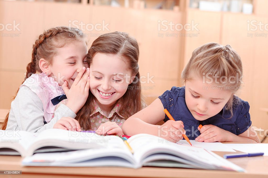 Girls with opened books in classroom stock photo
