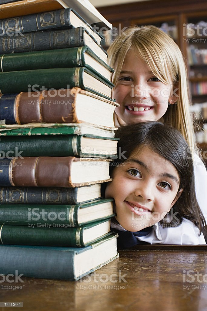 Girls with stack of books royalty-free stock photo