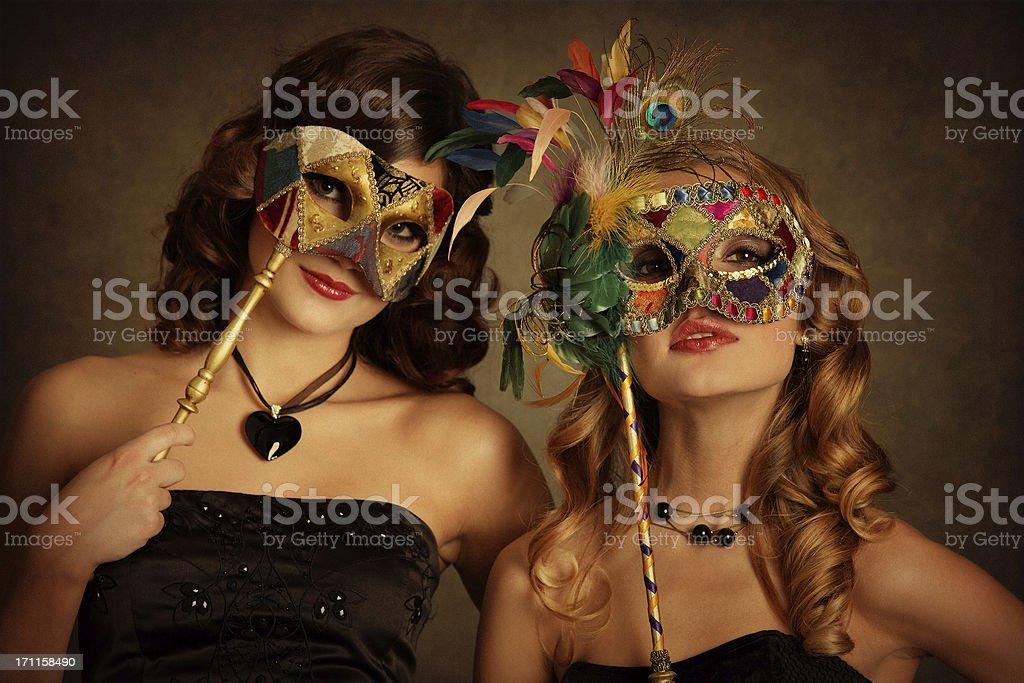 girls with venetian mask stock photo