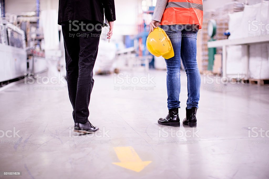 Girls working in a factory stock photo