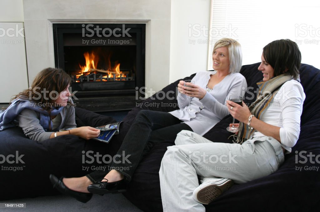 girlsfriend drink red wine and chat royalty-free stock photo