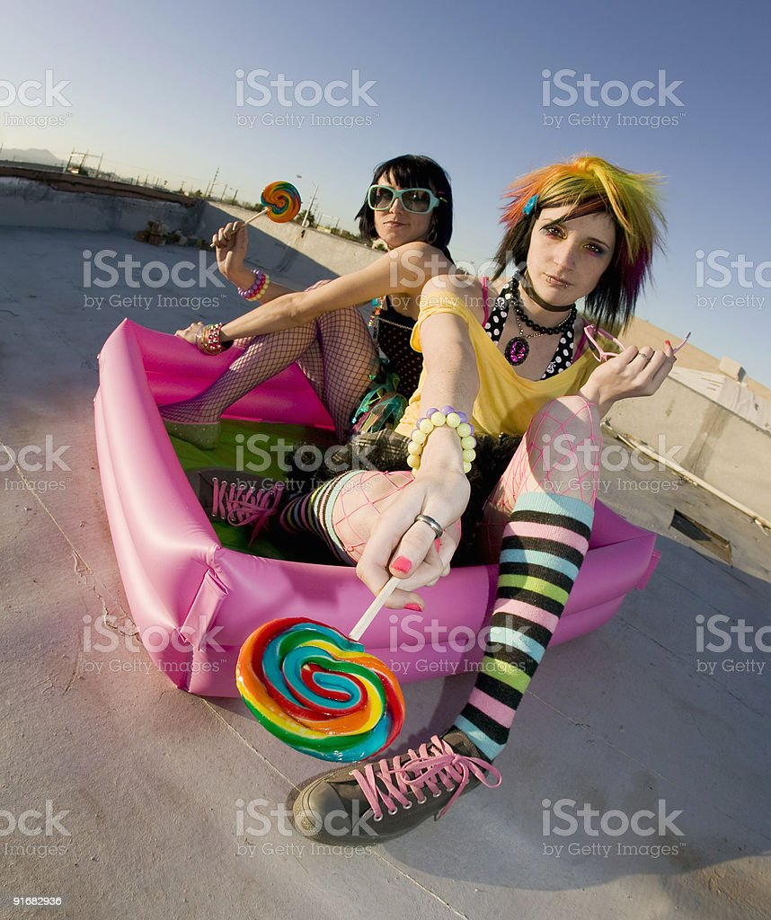 Girsl on roof in a plastic pool royalty-free stock photo