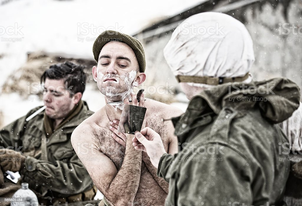 WWII GIs Shaving and Brushing Teeth in Winter stock photo