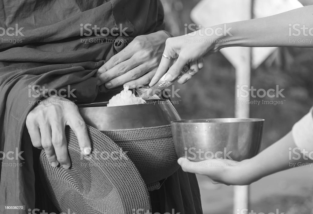 Give alms to a Buddhist monk royalty-free stock photo