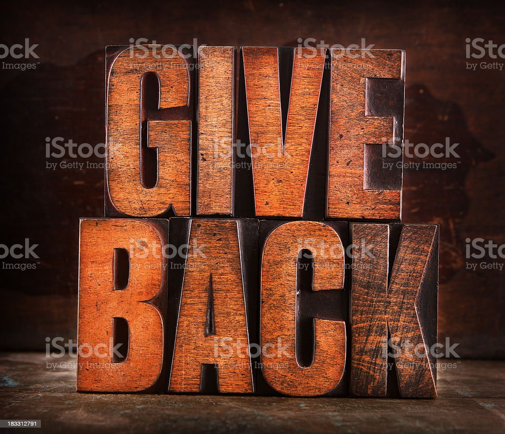 Give Back - Letterpress letters royalty-free stock photo