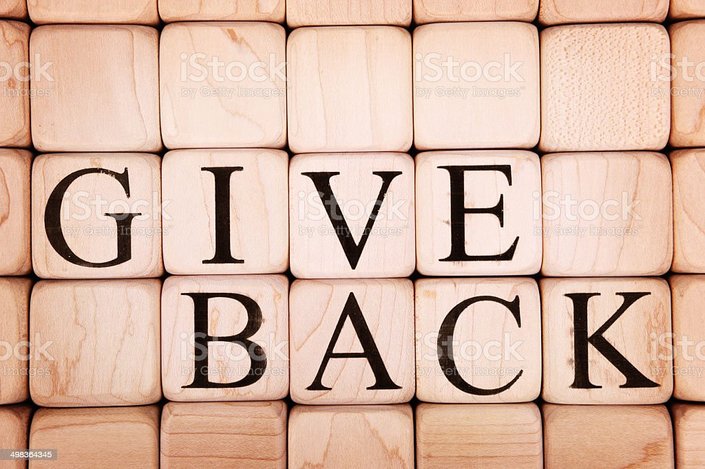Give Back Spelled Out Among Blank Blocks stock photo
