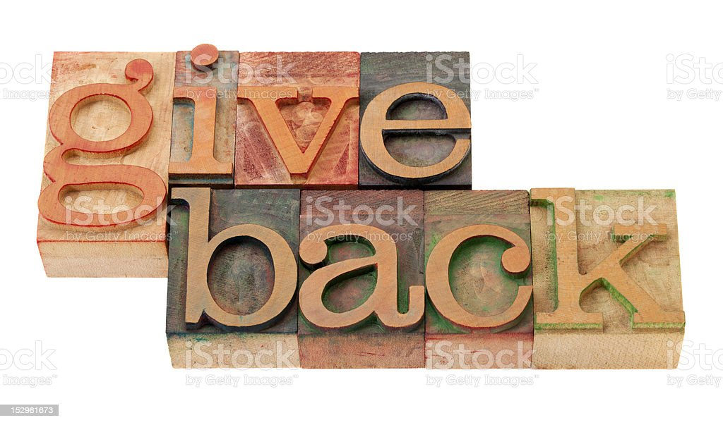 give back words  in wood fonts royalty-free stock photo