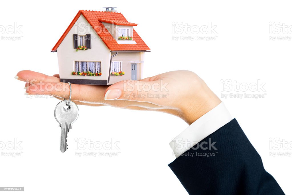 give house and key - concept of real estate purchase stock photo