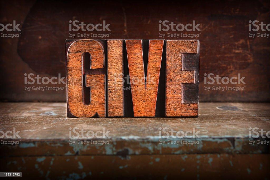 Give - Letterpress letters stock photo