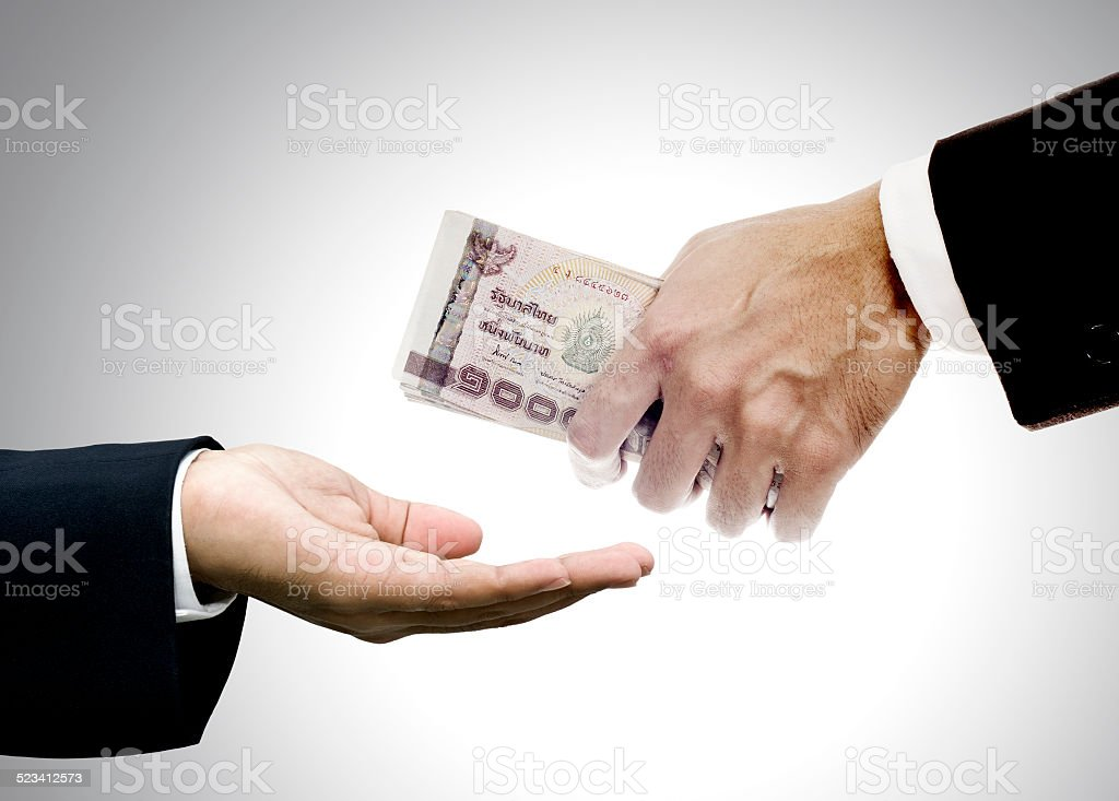 Give money to brokers stock photo