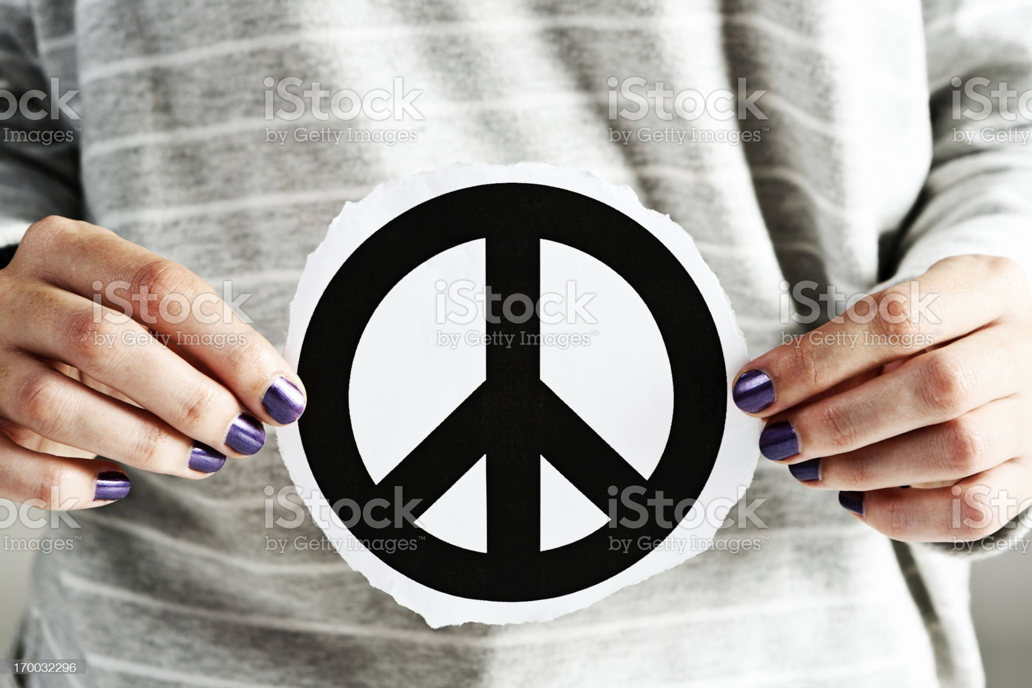 Give peace a chance! Feminine hands hold CND symbol royalty-free stock photo