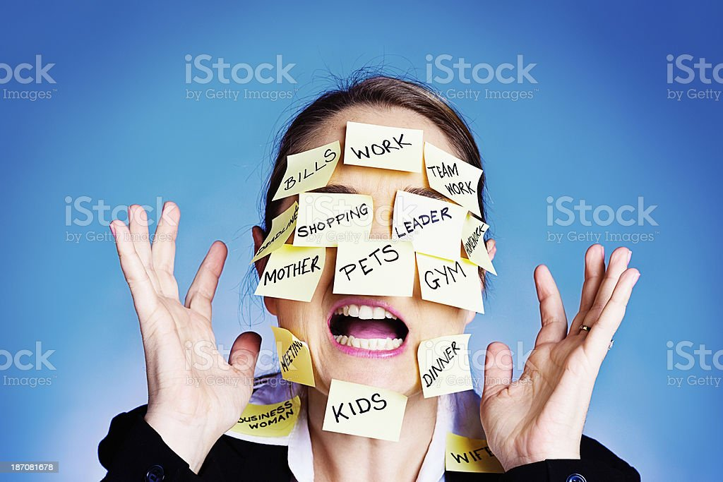 I give up! Overwhelmed woman covered in  task reminders royalty-free stock photo