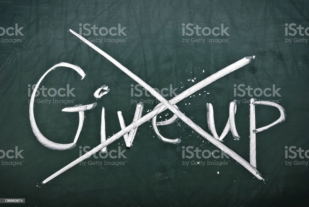 Give up written down which has been crossed out in defiance royalty-free stock photo