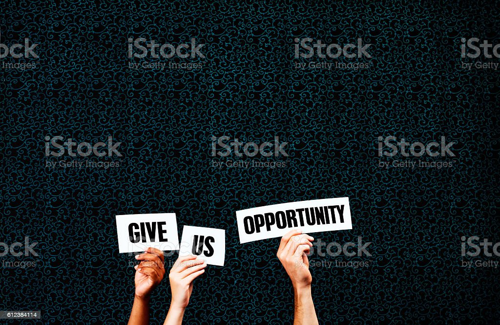 'Give us Opportunity' say hand-held words stock photo