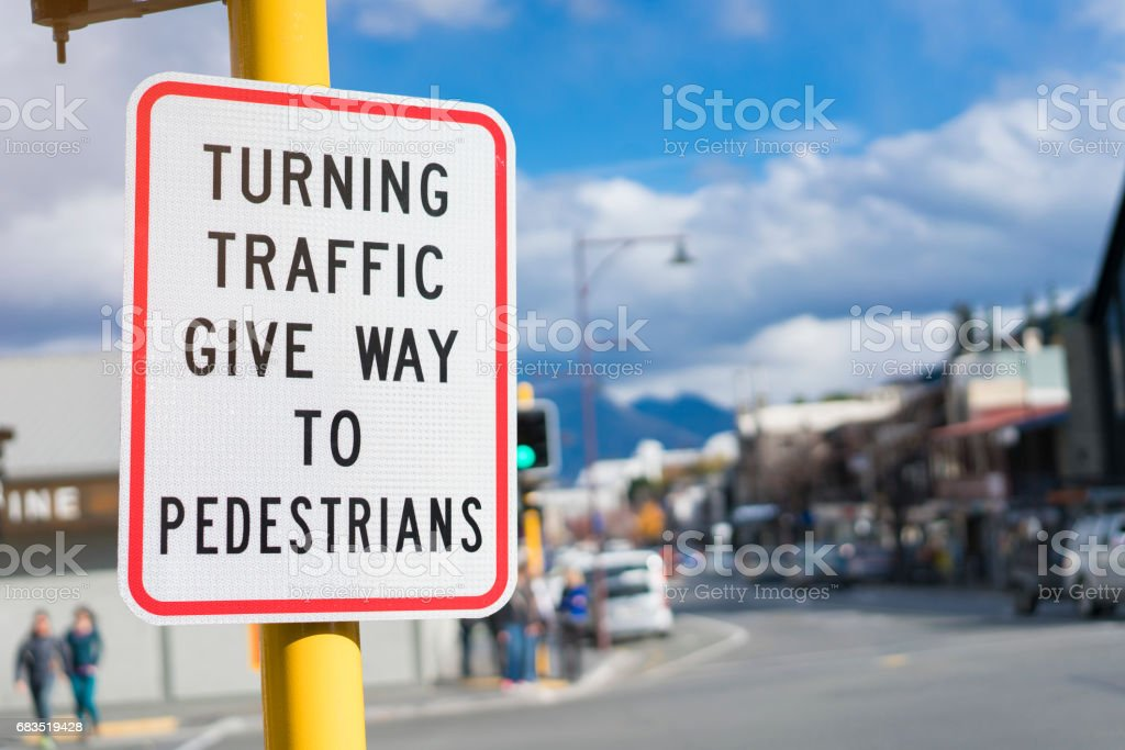 give way to pedestrian sign stock photo