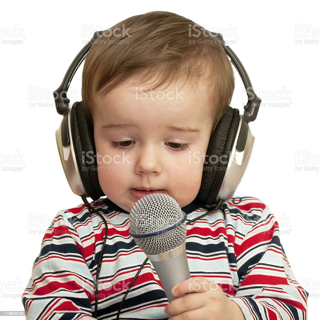 Given a speech toddler with headphones and microphone royalty-free stock photo