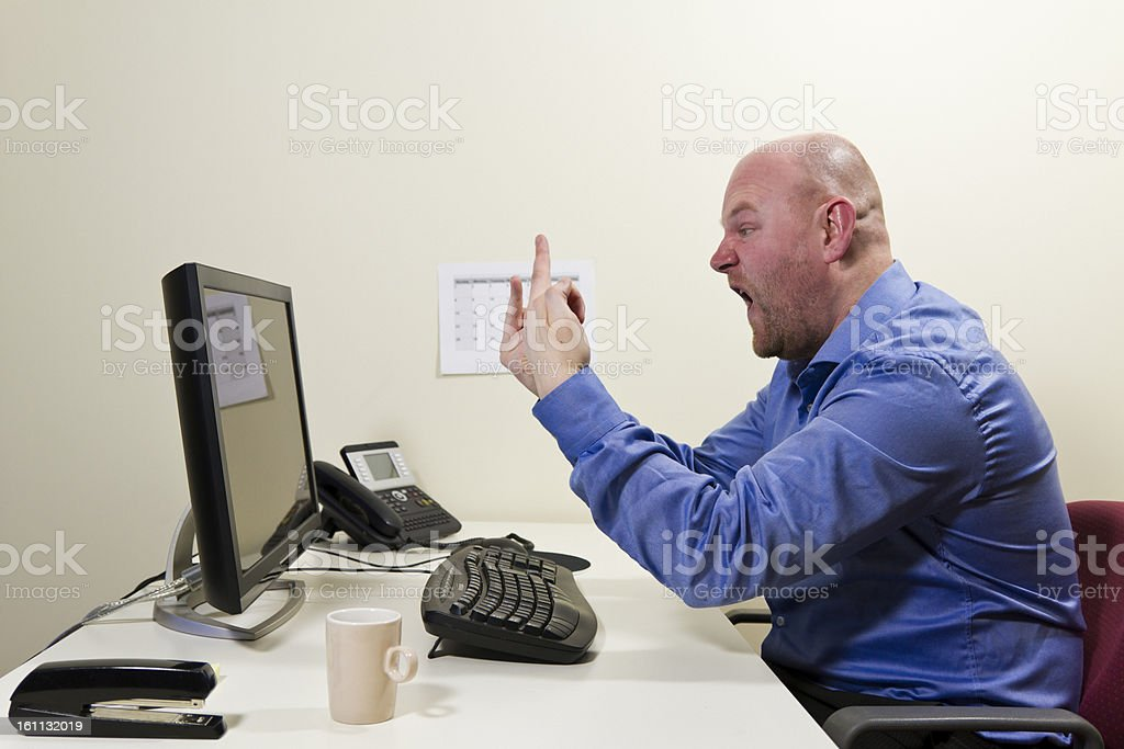 Gives Finger to the Computer royalty-free stock photo