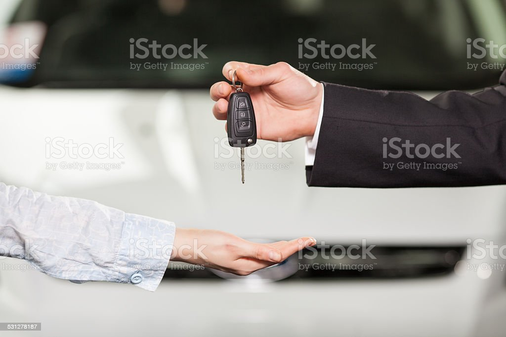 gives the keys to the car stock photo