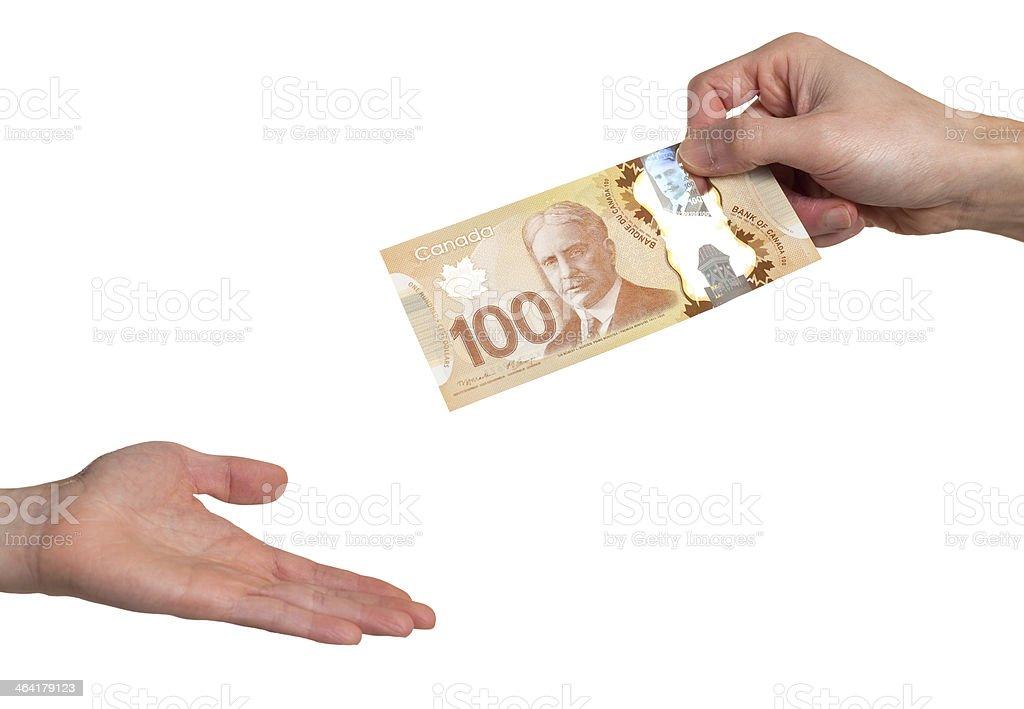 Giving 100 Dollar Bill stock photo