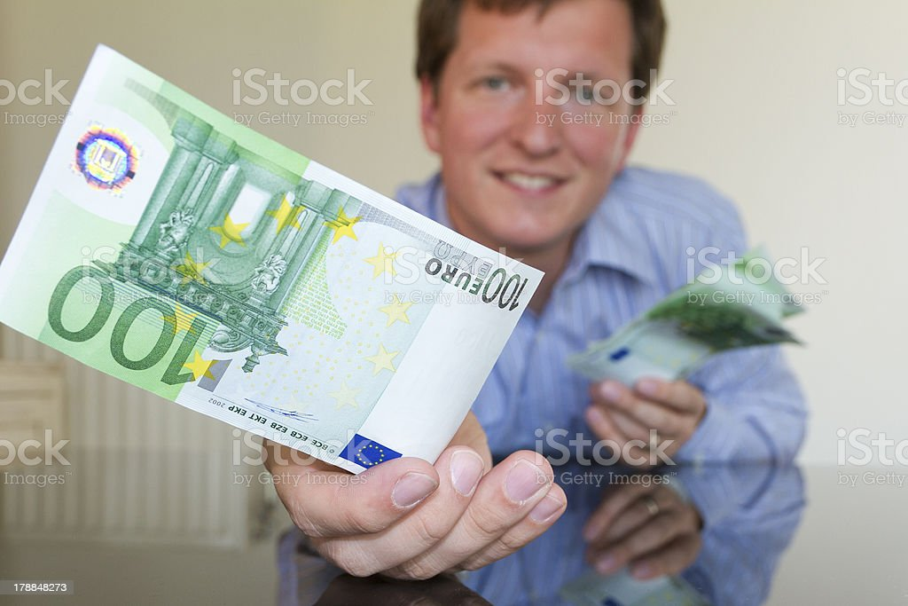 Giving 100 Euro II (square) royalty-free stock photo