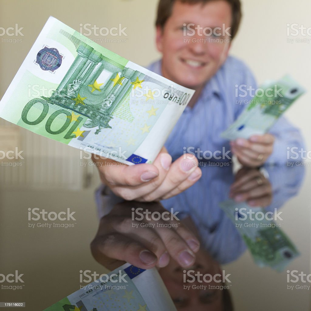 Giving 100 Euro III (Square) royalty-free stock photo