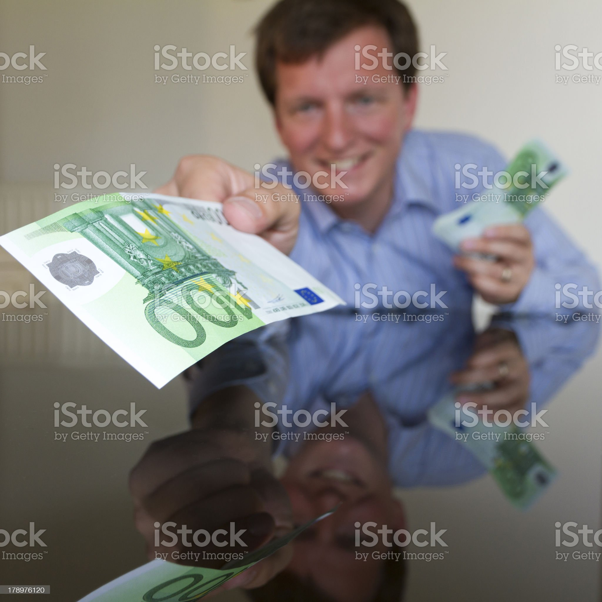Giving 100 Euro IV (square) royalty-free stock photo